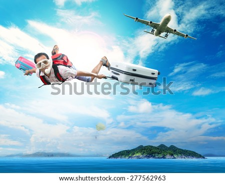 young man flying on blue sky wearing snorkeling mask and holding luggage use for people traveling by plane to destination sea island and summer vacation holiday theme - stock photo