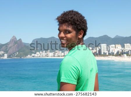 Young man from Rio de Janeiro at beach - stock photo