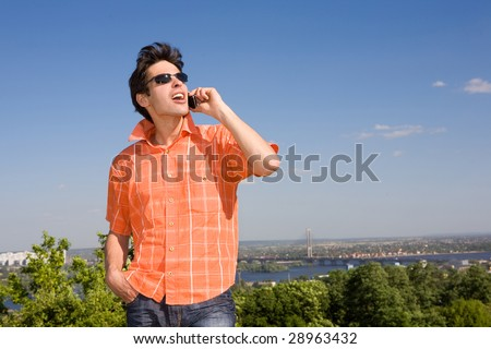 Young man from the phone calls. It was on Mount. - stock photo