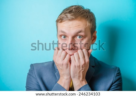 young man. Gesture. does not know what to do, confusion - stock photo