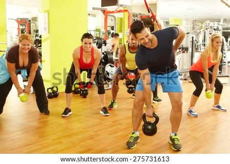 Young man getting injured in gym during fitness workout. - stock photo