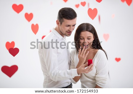 Young man gives her a ring - stock photo