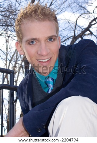 young man giving a flirt smile - stock photo