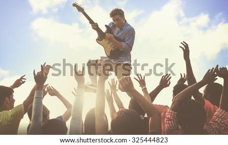 Young Man Guitar Performing Concert Concept - stock photo