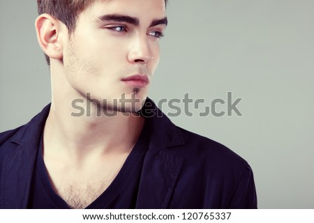 Young man handsome face closeup, sexy guy looking at camera, isolated - stock photo