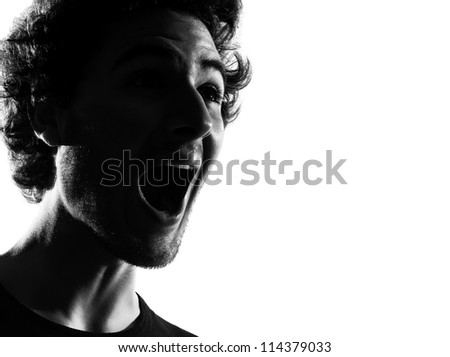 young man happy screaming silhouette in studio isolated on white background - stock photo