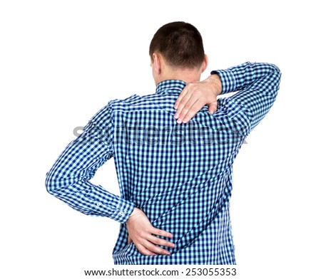 Young man having back pain. Isolated on white - stock photo