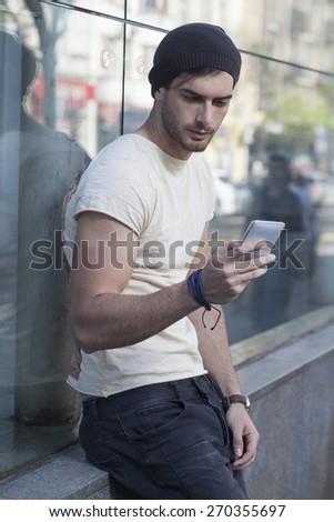 Young man having fun talking by phone.  - stock photo