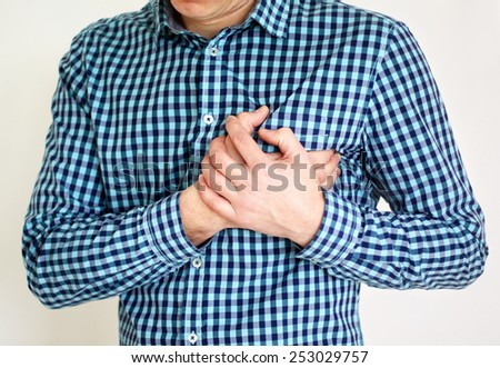 Young man having heart pain - stock photo