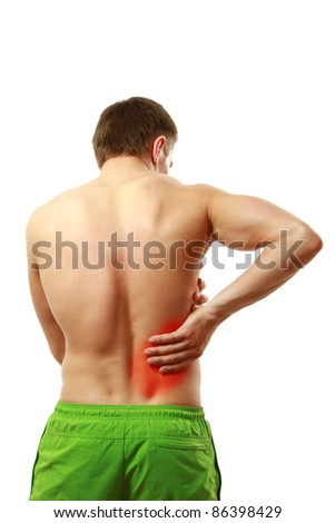 Young man having pain in his back - stock photo