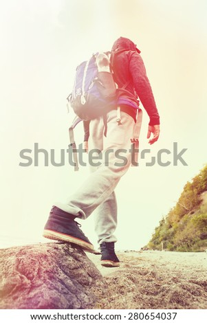 Young man hiker hiking on the beach. Lomo effect - stock photo