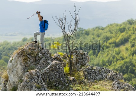 Young man hiking on the mountain - stock photo