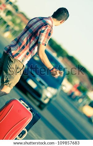 Young Man Hitchhiking - stock photo