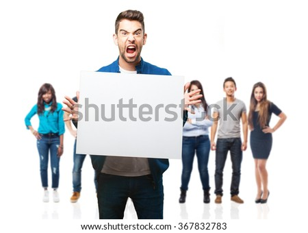 young man holding a banner - stock photo