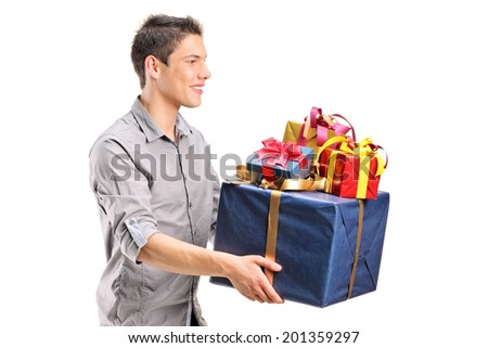 Young man holding a bunch of presents isolated on white background - stock photo