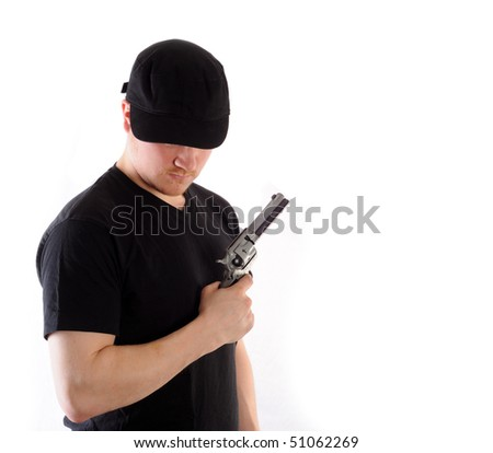 Young man holding a gun, isolated on white - stock photo