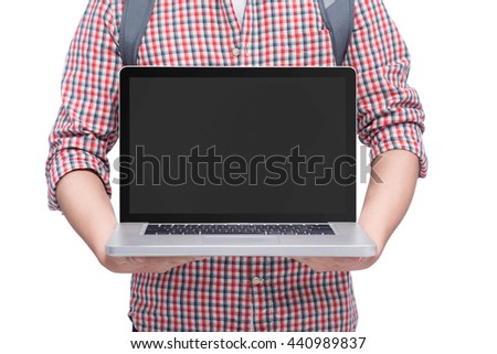 Young man holding a laptop displaying the screen - isolated over white - stock photo