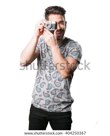 young man holding a vintage camera - stock photo