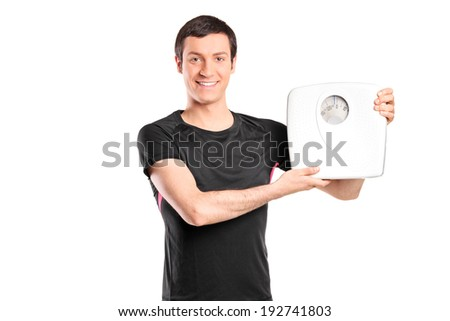 Young man holding a weight scale isolated on white background - stock photo
