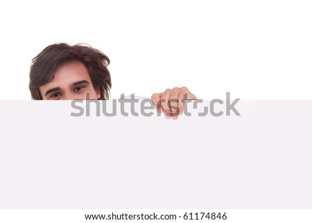 Young man holding a white board, looking to camera, isolated on a white background - stock photo