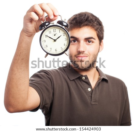 young man holding an alarm clock on a white background - stock photo