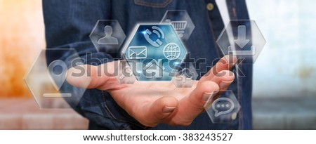 Young man holding application icons interface in his hand - stock photo