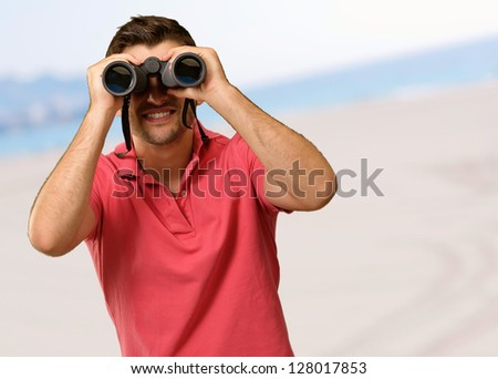 Young Man Holding Binoculars, Outdoor - stock photo