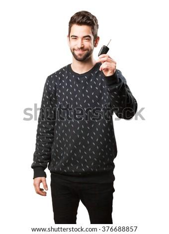 young man holding car keys - stock photo