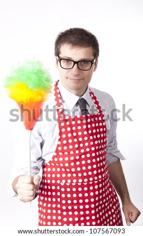 Young man holding duster. - stock photo