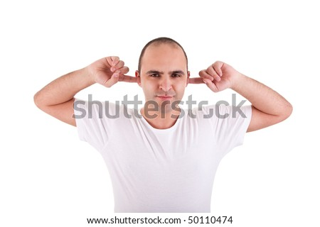 Young man, holding fingers in his ears, protecting himself from noise - stock photo