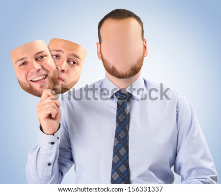 young man holding happy and sad mask - stock photo