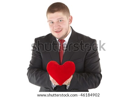 Young man holding heart in his hand. He is giving it somebody. Isolated over white. - stock photo