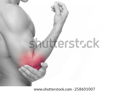 Young man holding his elbow in pain, isolated on white background - stock photo
