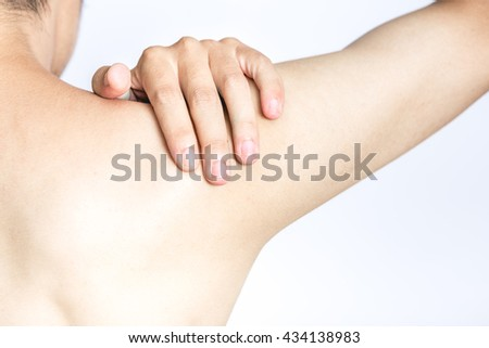 Young man holding his shoulder in pain, isolated on white background - stock photo