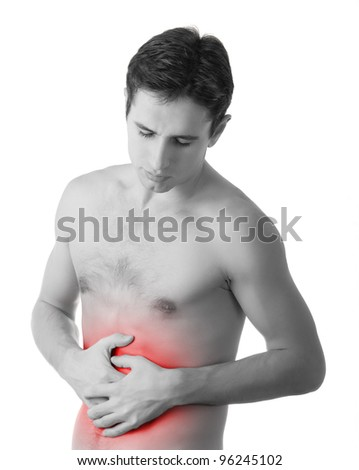 young man holding his sick stomach in pain, isolated on white background, monochrome photo with red as a symbol for the hardening - stock photo
