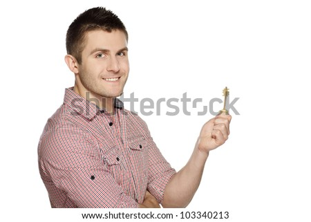 Young man holding house key isolated over white background - stock photo