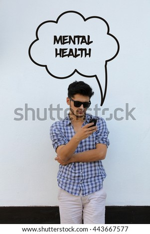 Young man holding mobile phone writen Mental Health on it - stock photo