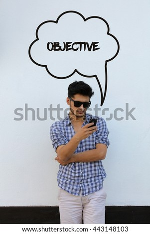 Young man holding mobile phone writen Objective on it - stock photo