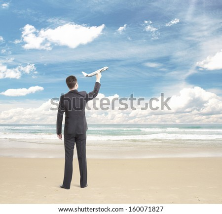 young man holding plane, travel concept - stock photo