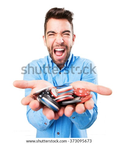 young man holding poker chips - stock photo