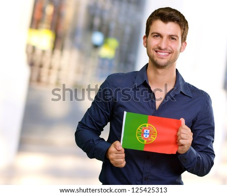 Young Man Holding Portuguese Flag, Outdoor - stock photo