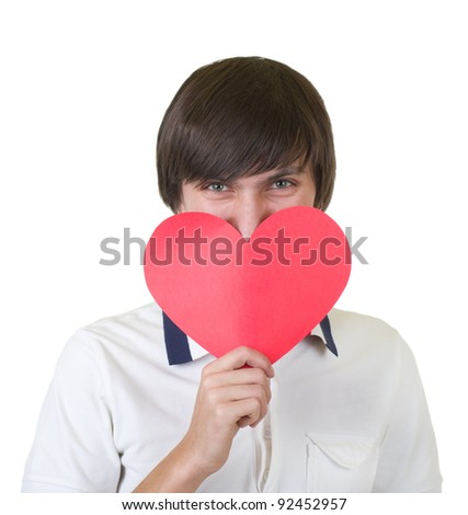 Young man holding red heart isolated on white background - stock photo
