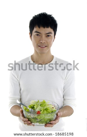 young man holding salad - stock photo