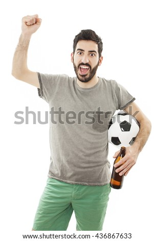 Young man holding soccer ball in hand. He's happy and looking at camera. Isolated on white background.  - stock photo