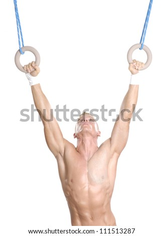 Young man holding two rings.Gymnastic on rings. - stock photo