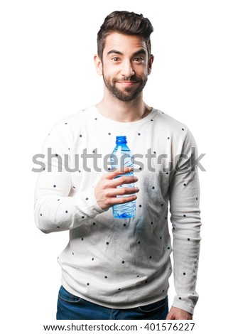young man holding water bottle - stock photo