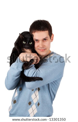 Young man holds black cat in hands - stock photo
