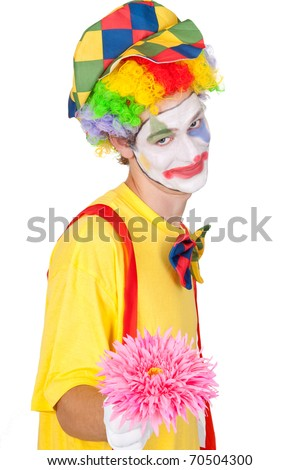 Young man in a clown's costume holding a pink flower - isolated - stock photo