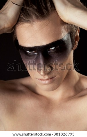 young man in a mask - face painting fashion project - stock photo