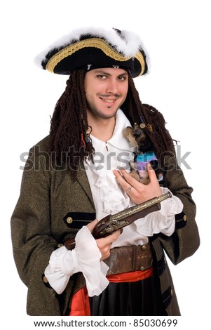 Young man in a pirate costume with small dog - stock photo